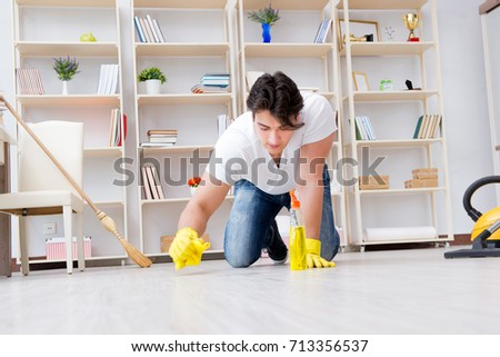 Man doing cleaning at home #713356537