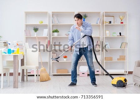 Man doing cleaning at home #713356591
