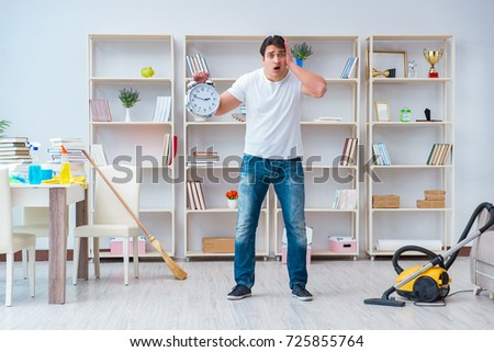 Man doing cleaning at home #725855764