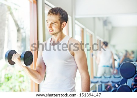 man doing exercises at home or in gym