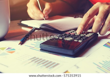 Man doing finance and calculate on desk about cost at home office.