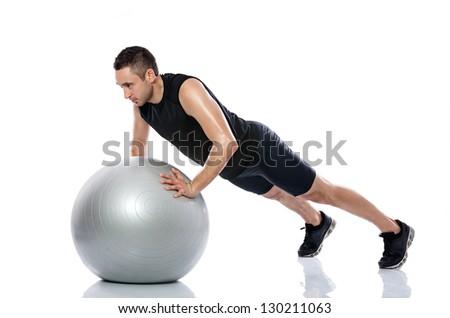 Man doing fitness exercise on pilates ball