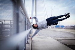 Man doing human flag exercise outdoor