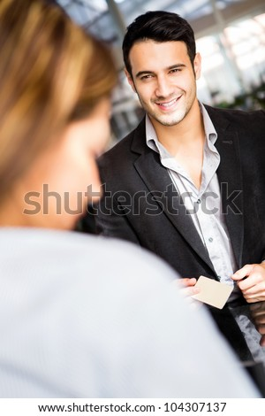 Man doing the check in at a hotel