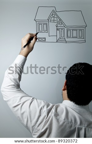 Man drawing a home