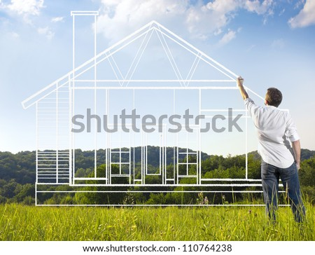 Man drawing a house blueprint in nature