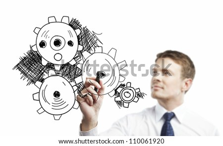man drawing gears on a white background