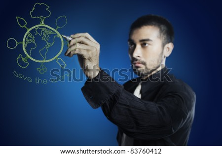 Man drawing green world,save energy ,global warming concept