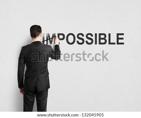 man drawing impossible on wall