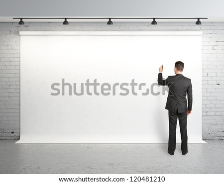 man drawing on white backdrop