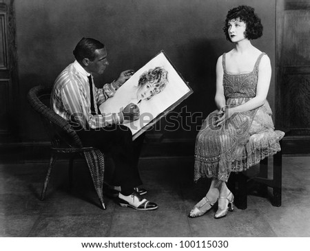 Man drawing portrait of woman - stock photo
