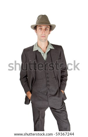 Man dressed as a private detective in the studio