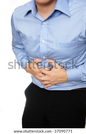 Man dressed in formal wear having a stomach ache - stock photo