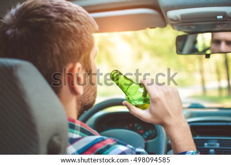 man drinking alcohol while driving the car #498094585