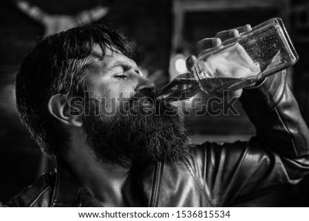 Man drinking alcohol. Whisky, brandy or cognac concept. Serious sad man having alcohol addiction. Alcohol addiction concept #1536815534