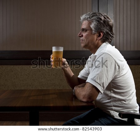 Man drinking alone - stock photo