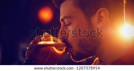 Man drinking beer in bar