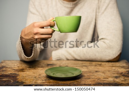 Man drinking from cup #150050474