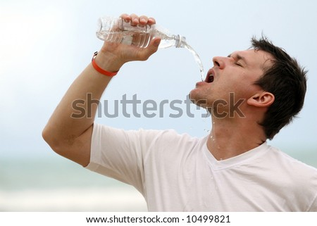man drinking water after sport training