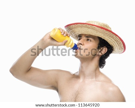 Man drinking water from a water bottle