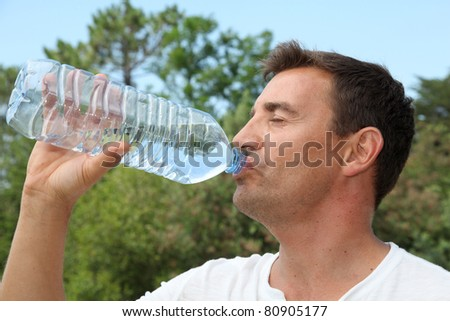 Man drinking water from bottle