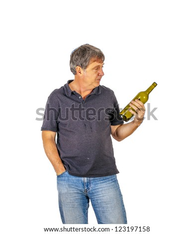 man drinks alcohol out of a bottle