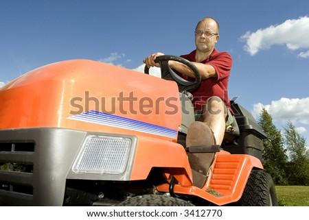 Man driving a lawnmower