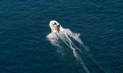 Man driving an inflatable boat with a motor
