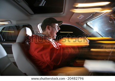 Man driving car at night, speeding fast.