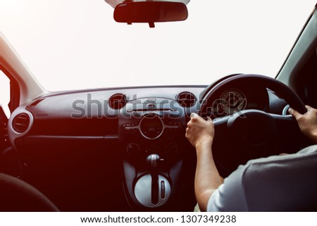 Man driving car on the road isolated on white background. Drive to travel, drive to work, drive to various places #1307349238