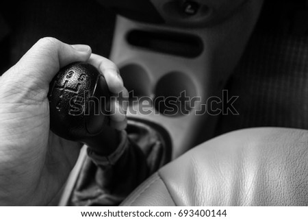 Man driving control car with a manual transmission car. #693400144