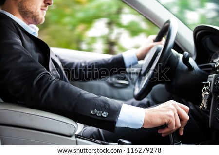 Shutterstock Man driving his car