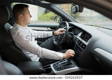 Man driving his car #504262837
