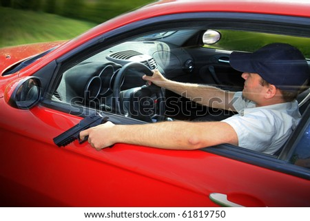 Man driving with the gun