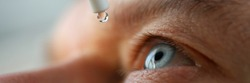 Man drops eye drops install lenses, moisturizing. Preservation and solution vision problems. Eye diseases are recognized. Drops before putting on lenses or before removing at end day