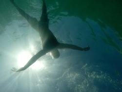 Man drowning viewed from below underwater