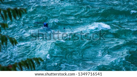 man drowning while kayaking in whitewater Kayaker getting caught in a rapid in an Himalayan waters in rishikesh India