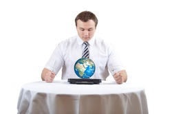 Man eat Earth on notebook as plate on lunch