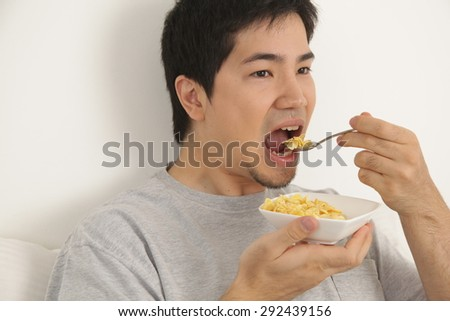 Man eating cereals