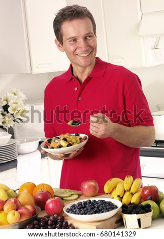 MAN EATING FRUIT SALAD #680141329
