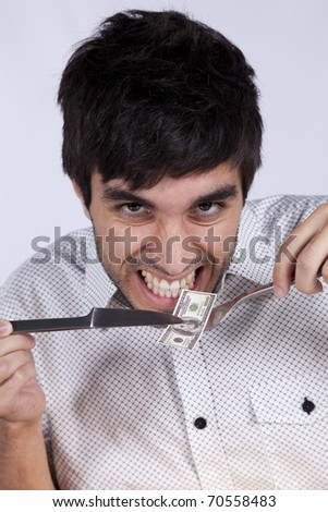 Man eating money with a fork and a knife