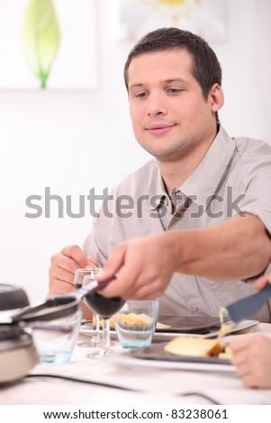 Man eating raclette