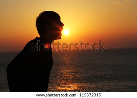 Man eating sunset