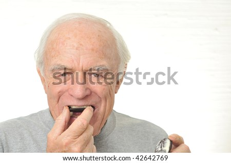 Man eats a cream filled cookie in two halves.
