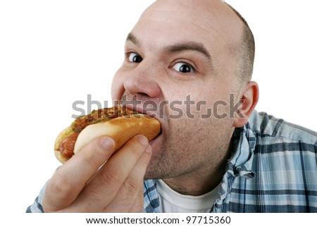 man eats a hot dog