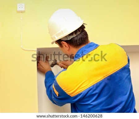 man electrician installs electrical network
