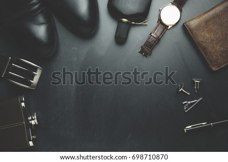 man elegant  and different accessorise on black background #698710870