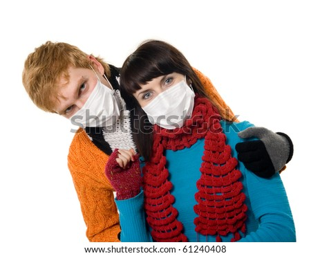 man embraces a woman wearing masks, flu, A(H1N1), on the white grey background
