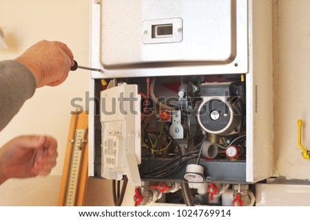 Man engineer and gas heater. Repair and work scene.