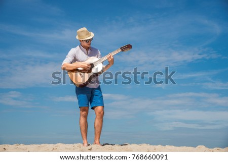 man enjoy with the nature at the sea beach with guitar in hand, daylight sunny enjoyment #768660091